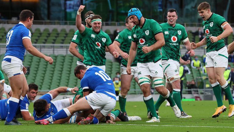 Ireland players celebrate as CJ Stander scores their first try against Italy