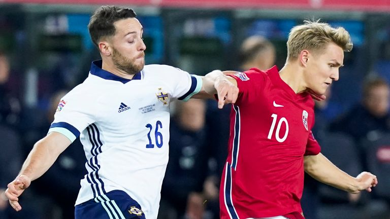 Northern Ireland's forward Conor Washington (L) and Norway's midfielder Martin Odegaard vie for the ball