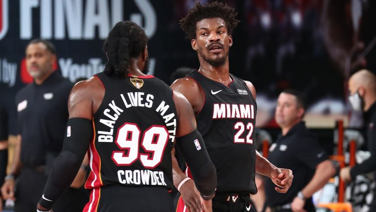 Jae Crowder high-fives Jimmy Butler of the Miami Heat during the NBA Finals