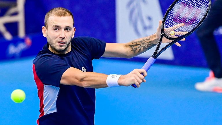 Dan Evans progressed through to the next round after his opponent retired injured