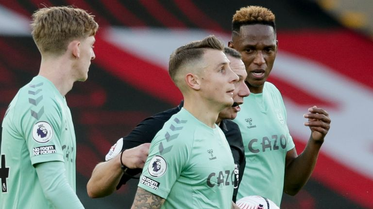 Referee Kevin Friend gives Lucas Digne of Everton a helping hand and a straight red after his tackle on Kyle Walker-Peters of Southampton during the Premier League match between Southampton and Everton at St Mary's Stadium on October 25, 2020 in Southampton, England.