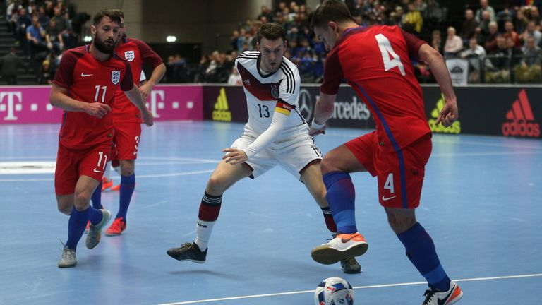 Nils Klems (C) of Germany and Douglas Reed of England compete for the ball during the Futsal International Friendly match between Germany and England at Inselparkhalle on November 1, 2016 in Hamburg, Germany