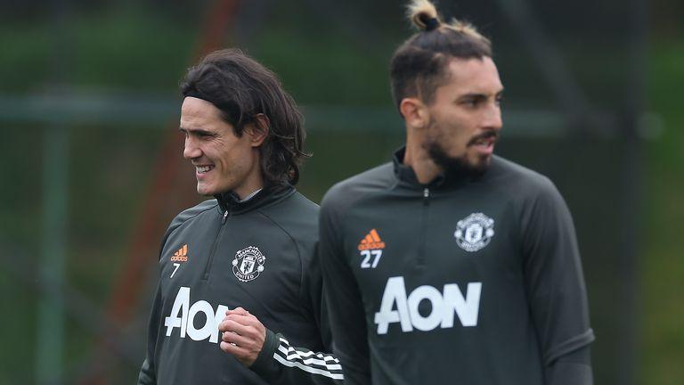 Edinson Cavani pictured alongside fellow new signing Alex Telles