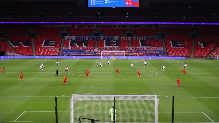 England and Wales players take a knee before kick-off during a October friendly at Wembley