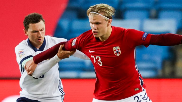 Striker Erling Haaland holds the ball up for a Norway attack in Oslo