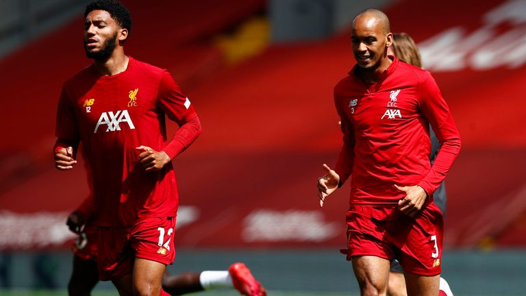 Joe Gomez and Fabinho of Liverpool warm up prior to the Premier League match between Liverpool FC and Burnley FC at Anfield on July 11, 2020 in Liverpool, England. Football Stadiums around Europe remain empty due to the Coronavirus Pandemic as Government social distancing laws prohibit fans inside venues resulting in all fixtures being played behind closed doors. (Photo by Clive Brunskill/Getty Images)