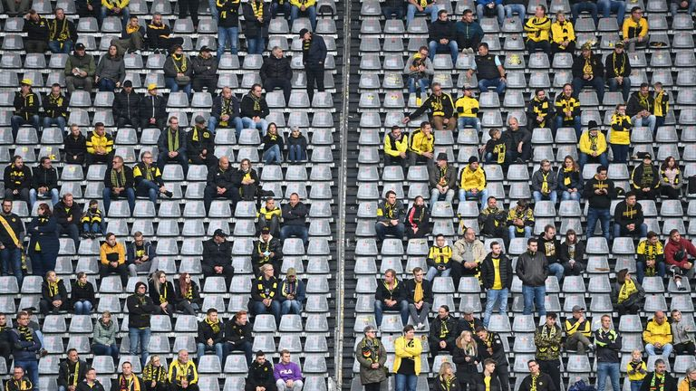 Spectators keep distance in the stands during the Bundesliga match between Borussia Dortmund and SC Freiburg in October