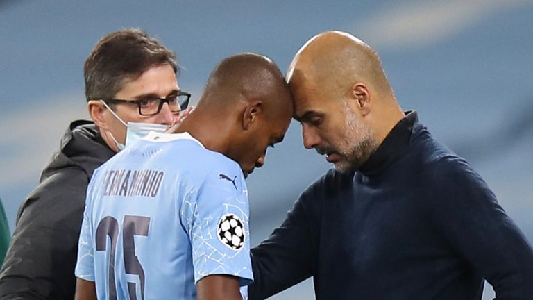 Pep Guardiola consoles Fernandinho after the midfielder suffered a recurrence of a muscle injury