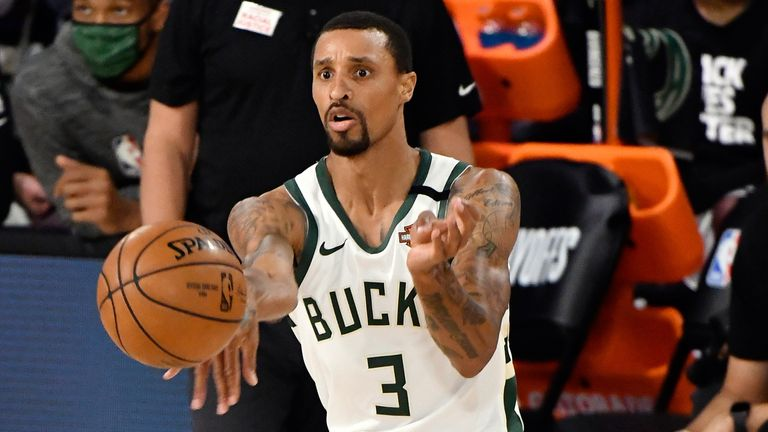 George Hill passes to a Bucks team-mate during a game inside the NBA bubble