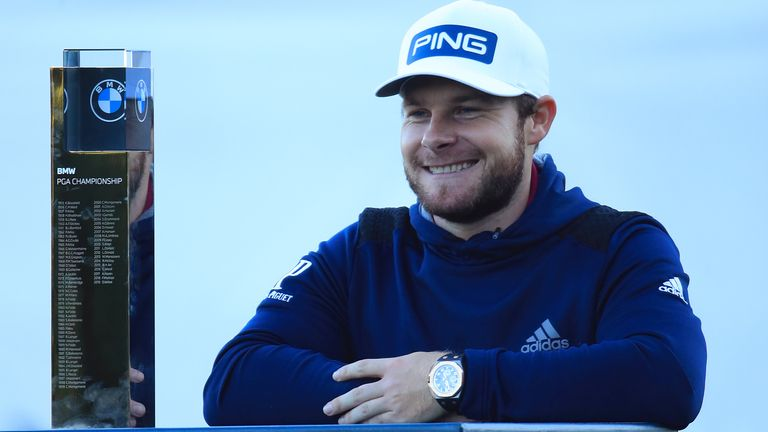 Hatton poses with the trophy following his four-shot win