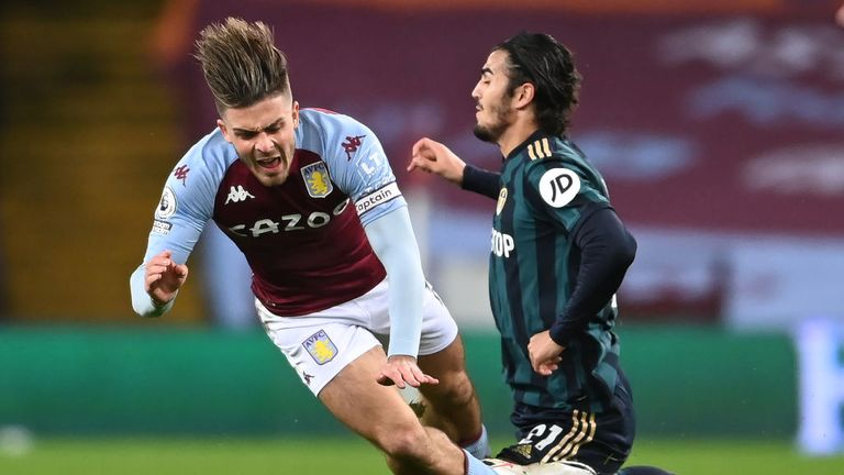 Jack Grealish of Aston Villa is tackled by Pascal Struijk of Leeds United