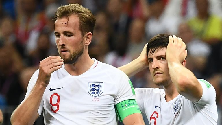 Harry Kane and Harry Kane on England duty, looking despondent