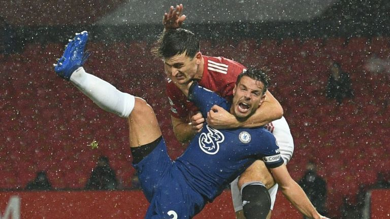 Harry Maguire was fortunate to avoid giving away a penalty for this hold on Cesar Azpilicueta