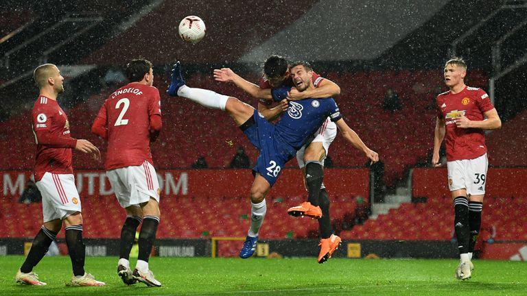 Harry Maguire climbs over Cesar Azpilicueta to head clear