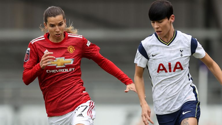 Tobin Heath of Manchester United Women and Ashleigh Neville of Tottenham Hotspur Women