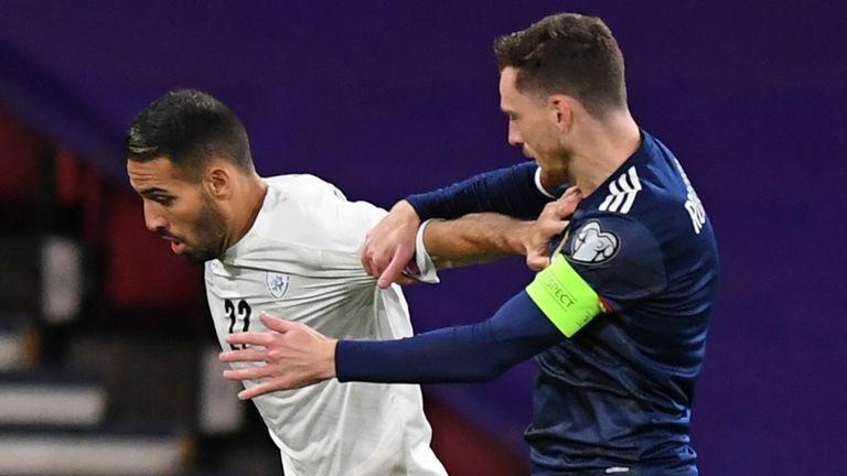 Israel midfielder Eyal Golasa vies with Scotland defender Andrew Robertson