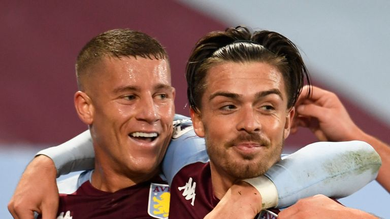 Scorer of Villa's sixth goal, Jack Grealish celebrates with Ross Barkley and John McGinn