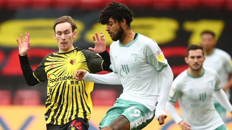 James Garner of Watford battles for possession with Philip Billing of Bournemouth