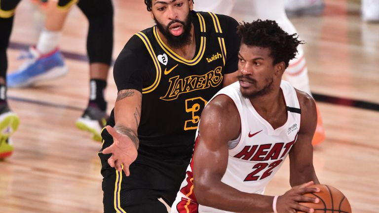 Anthony Davis of the Los Angeles Lakers plays defense on Jimmy Butler of the Miami Heat during Game Five