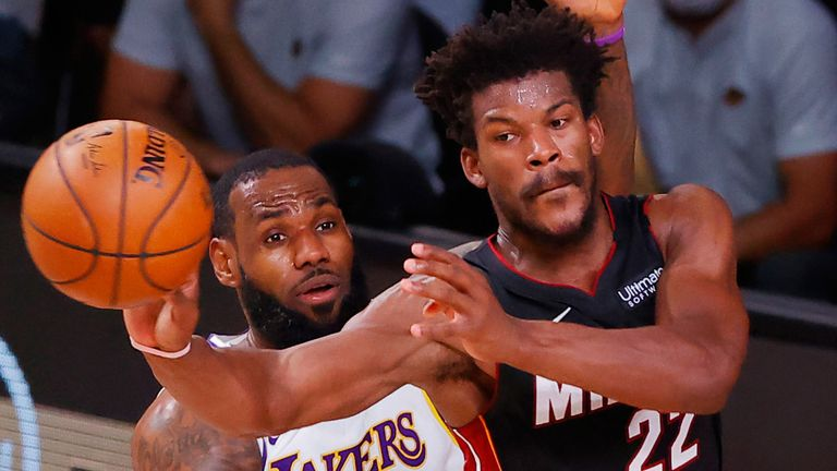 Jimmy Butler, guarded by LeBron James, passes to a team-mate during Game 3 of the NBA Finals
