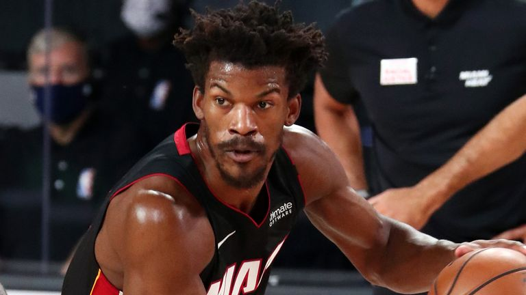Jimmy Butler drives by LeBron James in Game 1 of the NBA Finals