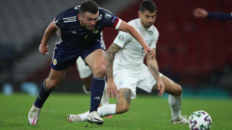 Scotland;s John McGinn battles for the ball in the Euro 2020 play-off semi-final against Israel