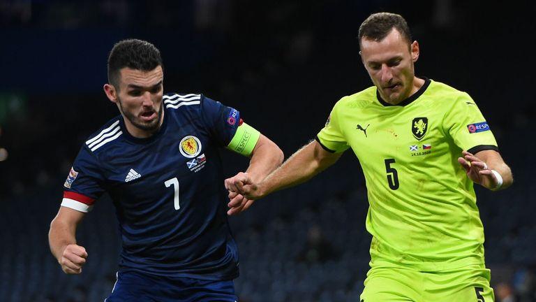 Czech Republic's defender Vladimir Coufal (R) takes on Scotland midfielder John McGinn