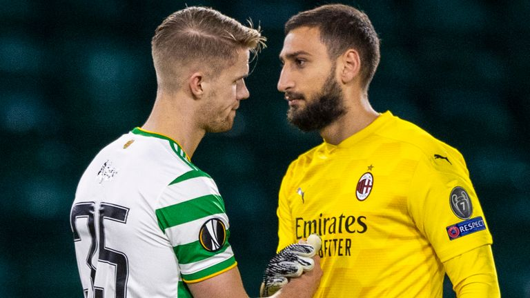 Celtic's Kristoffer Ajer (left) with AC Milan's Gianluigi Donnarumma during the UEFA Europa League match