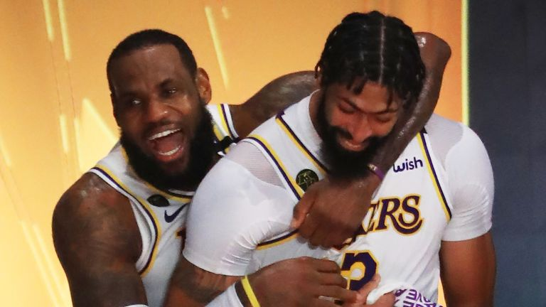 LeBron James hugs team-mate Anthony Davis after leading the Lakers to a series-clinching Game 6 win over the Heat