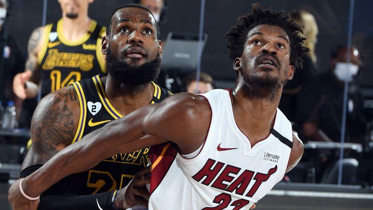 LeBron James and Jimmy Butler compete for a rebound during Game 5 of the NBA Finals