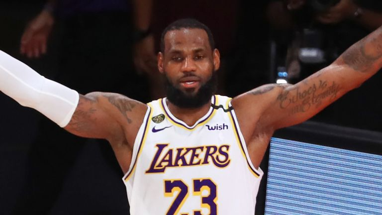 LeBron James celebrates after leading the Los Angeles Lakers to the NBA title