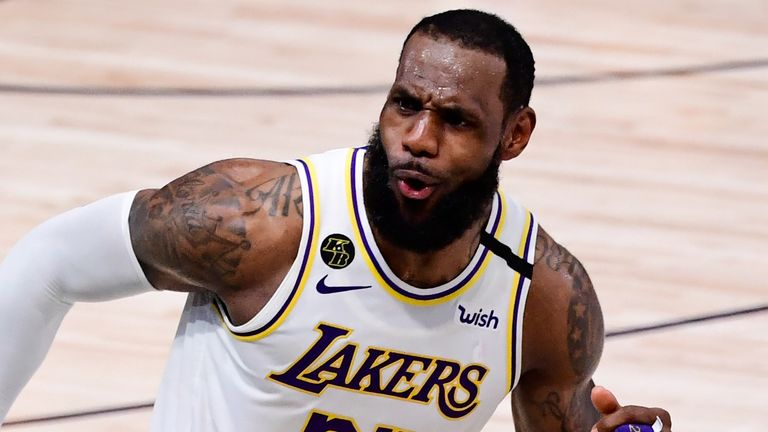 LeBron James celebrates a basket during the Los Angeles Lakers' Game 6 win over the Miami Heat
