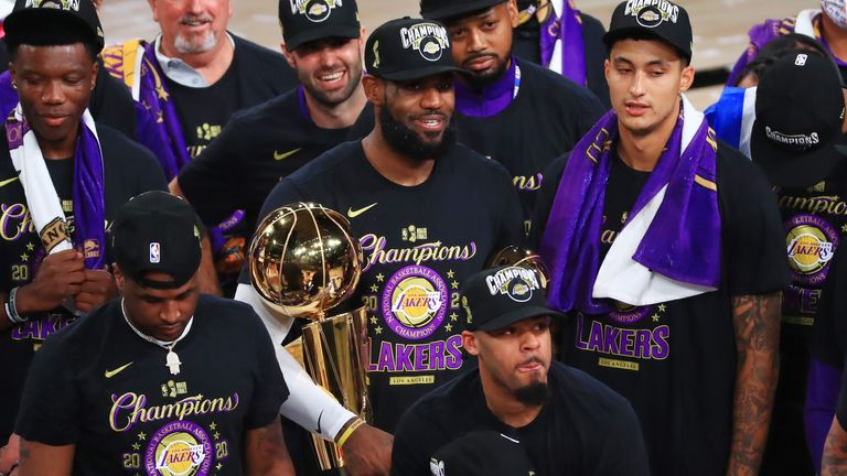 LeBron James and the Los Angeles Lakers celebrate with the Larry O'Brien trophy
