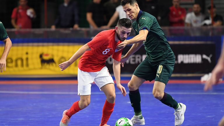 Alex Merlim of Italy vies with Liam Palfreeman of England during the 2020 FIFA Futsal World Cup Main Round Group 4 match between Italy and England on October 25, 2019 in Eboli, Ital