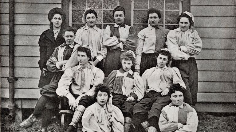 The determined-looking ladies of the 'South' football team who played the 'North' team at the in the opening match of the British Ladies' Football Club at Night