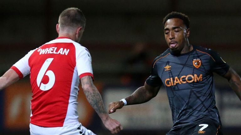 Mallik Wilks takes on Glenn Whelan during the League One fixture