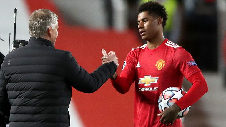 Manchester United's Marcus Rashford (right) and manager Ole Gunnar Solskjaer after the striker scored a hat-trick against RB Leipzig