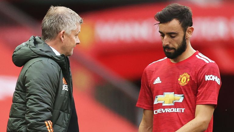 Ole Gunnar Solskjaer, Manager of Manchester United speaks with Bruno Fernandes of Manchester United during the Premier League match between Manchester United and Tottenham Hotspur at Old Trafford