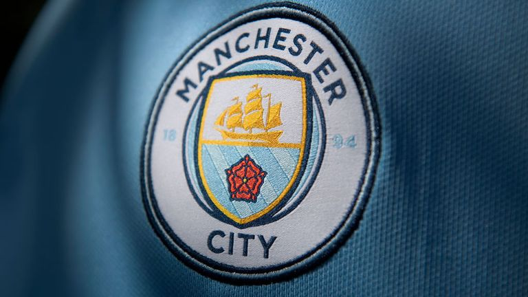 The Manchester City club crest on the first team home shirt displayed on May 5, 2020 in Manchester, England