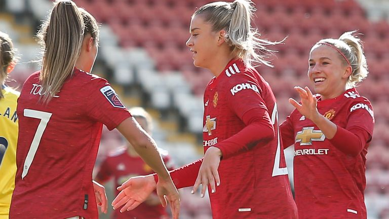 LEIGH, ENGLAND - OCTOBER 04: Ella Toone of Manchester United celebrates with teammates during the Barclays FA Women's Super League fixture between Manchester United and Brighton & Hove Albion at Leigh Sports Village on October 04, 2020 in Leigh, England. (Photo by Charlotte Tattersall/Getty Images)