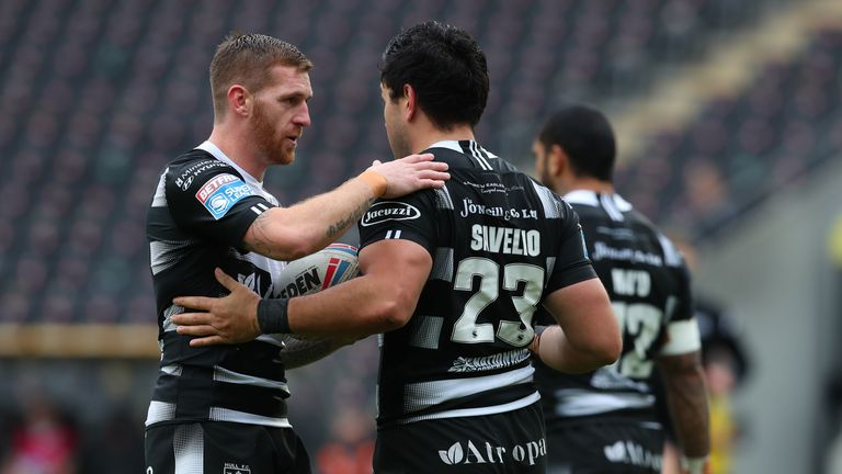 Marc Sneyd of Hull FC congratulates team-mate Andre Savelio on scoring a try