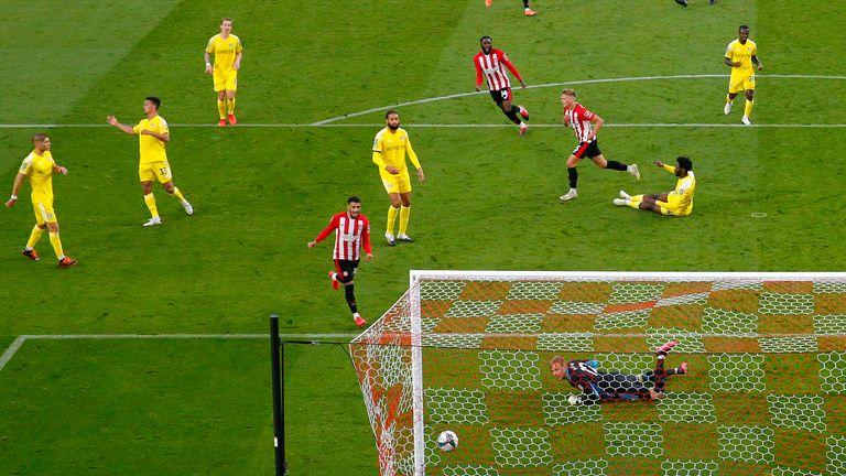Marcus Forss tucks away the opener for Brentford against Fulham