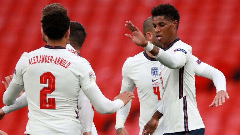 Marcus Rashford celebrates after scoring England's equaliser