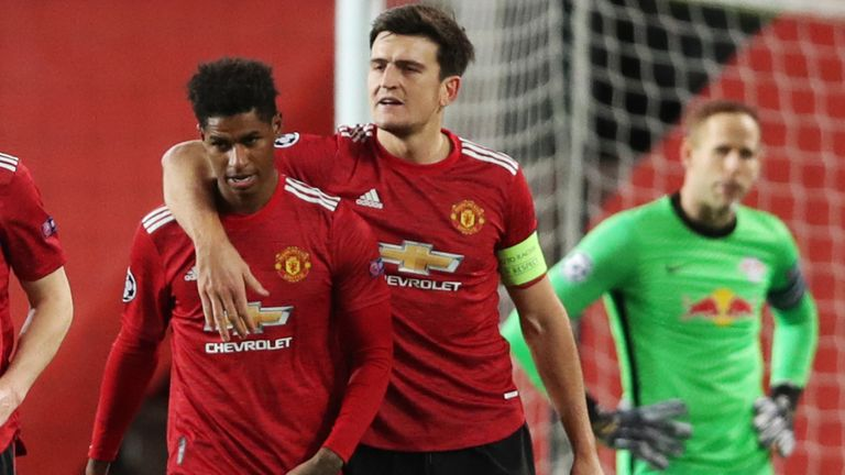 MANCHESTER, ENGLAND - OCTOBER 28: Marcus Rashford of Manchester United celebrates with his team mates after scoring his sides third goal during the UEFA Champions League Group H stage match between Manchester United and RB Leipzig at Old Trafford on October 28, 2020 in Manchester, England.