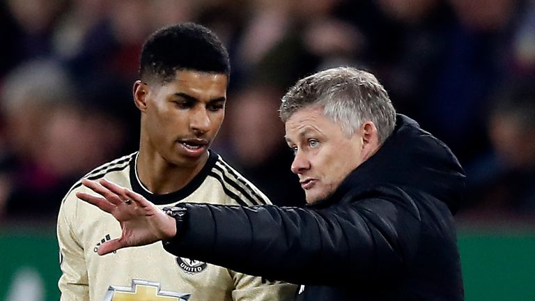 Manchester United manager Ole Gunnar Solskjaer (right) and Marcus Rashford talk on the touchline