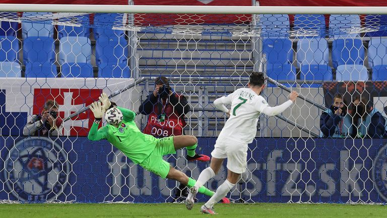 Marek Rodak dives to save Alan Browne's effort to give Slovakia the edge