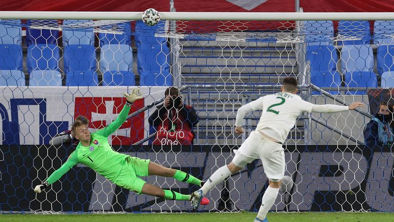 Matt Doherty hits the crossbar with his penalty as Slovakia progressed