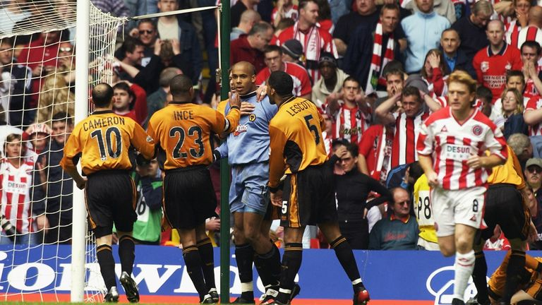 Wolves goalkeeper Matt Murray is congratulated by his team-mates after a saving a penalty in the 2003 Championship playoff final against Sheffield United