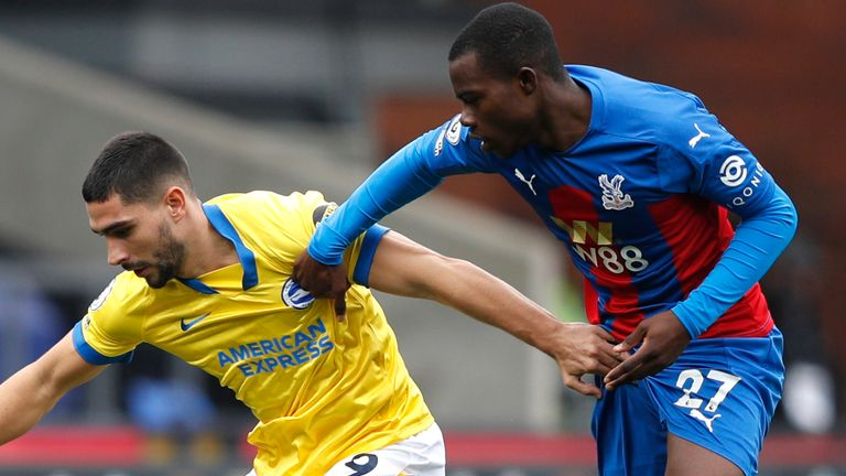 Brighton striker Neal Maupay is challenged by Tyrick Mitchell of Crystal Palace