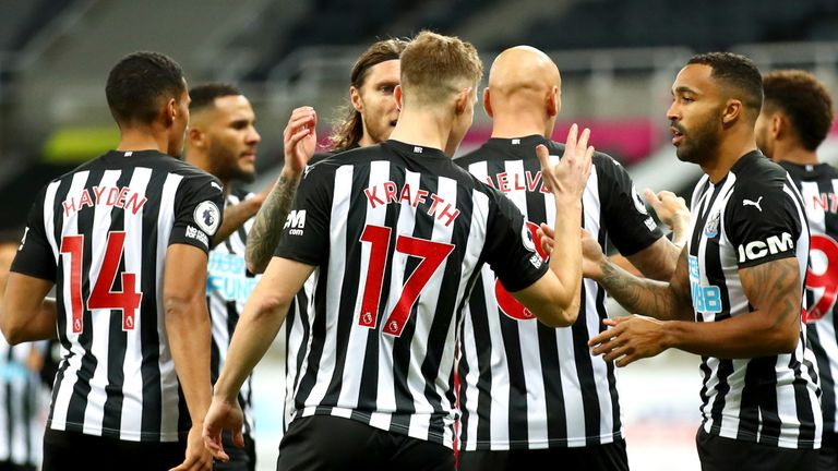 Newcastle players celebrate after taking the lead against Manchester United through Luke Shaw's own goal